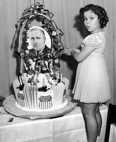 Shirley Temple gets ready to cut President Roosevelt's birthday cake, 1936