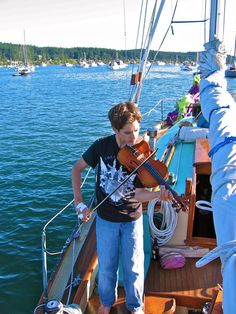 Robin demonstrates that even if pirates capture you and carry you off to sea you can still practice your violin!