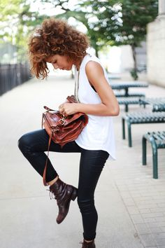 white tank, brown satchel, brown lace up booties