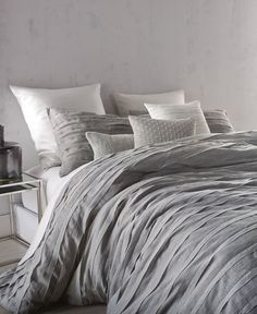 """A textured look brings stylish, modern appeal to the Loft Stripe cotton voile queen duvet cover from Dkny. 