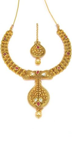 Lovely Golden And Pink Polki Necklace Set.