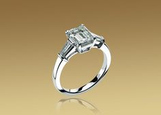 Bulgari Griffe solitaire ring in platinum with emerald cut diamond and 2 side diamonds.