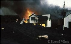 Houses getting eaten up by the lava during the 1973 Westman islands eruption.