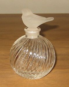 "Here we have a Beautiful Glass Bird Perfume Bottle. It is approx 3"" tall. It is in very good condition."