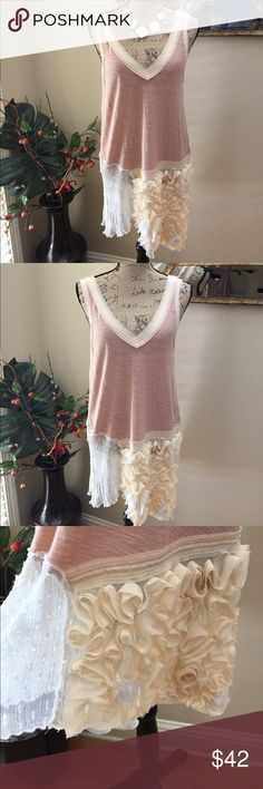 🌷FP stunning tunic tank with intricate flowers 🌷Free People stunning blush and Crean tunic tank with intricate flowers! This is a phenomenal FP long BOHO tank with 3-D Flowers and mesh detail. Super cute on and incredibly individual as only FP can do. I love this tank. It's just too big. Preloved in excellent condition. Free People Tops Tunics