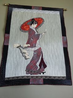 Geisha Girl, a Lonnie Rossi panel that was hand appliqued then cut out and hand appliqued onto the background fabric. It is machine pieced and quilted and hand appliqued, embroidered and embellished. Beautiful quilt. Peace, Robert from nancysfabrics.com