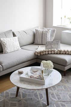 NYC Living Room Apartment - grey sectional sofa with a marble coffee table