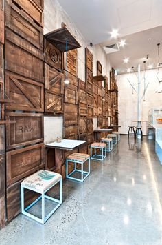 Tactile elements such as the textural wallpaper on the back wall panels have an industrial, raw look, which complement the slick, polished-concrete surfaces of the bar and floor.
