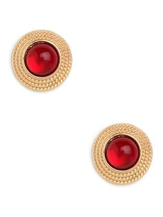 Crimson tides are turning toward the glam and ladylike—at least where these stunners are concerned. Just check out those hypnotic ruby gems, which come artfully framed in twisted gold.