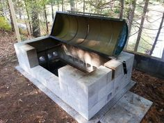 A large rotisserie pit BBQ for a large gathering! Learn how to build this DIY project in your backyard for some delicious turkey and other BBQ favourites! Bushcraft, Cinder Block Fire Pit, Cinder Blocks, Backyard Bbq Pit, Fire Pit Plans, Portable Fire Pits, Built In Bbq, Fire Pit Designs, Diy Fire Pit
