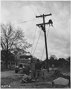 The TVA stringing Rural TVA Transmission lines. They are working under the Rural Electification Act, created by FDR in 1935.