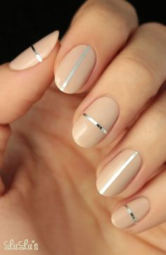 Nude nails with silver details.