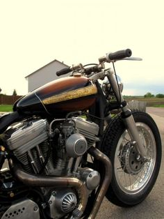 Sportster custom with super short z-bars and gold leaf detail on tank