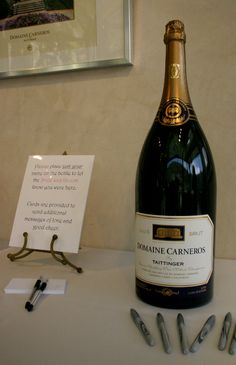 Cute idea for a guest book. Guests sign bottle with silver sharpie. Couple then opens bottle on 5 or 10 year anniversary