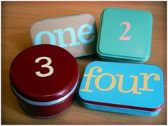 Use tins (like altoid or other small tins) to make an advent calender! Spray paint and use vinyl or other stickers or paint to add numbers to the top! If you're feeling really crafty you could line them with felt. At Christmas, just fill 'em up with little goodies and watch the kids have fun opening them every day!