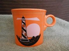Fiesta® Tangerine Lighthouse Mug made by Homer Laughlin China | WorthPoint