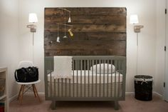 "If you're inspired by the rustic feel and relaxing style of organic elements, try using a mixed medium when decorating. Neutral shades for a calming effect and a rad, DIY wood ""headboard"" to round out the theme make this nursery not only original but fashion-forward too."