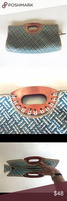 """Vintage wooden handled woven straw oversize clutch Awesome vintage rigid woven blue and tan straw oversized clutch with wooden handles. Hidden zipper.  15"""" long 8"""" tall  4"""" wide  Pocket is 4"""" deep and 15"""" long   RBM 631-7 OD Bags Clutches & Wristlets"""