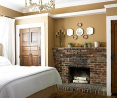 Warm, cozy sleep space with antique brick fireplace and old wood doors