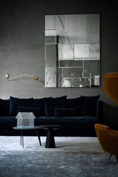 Navy sofa grey wall