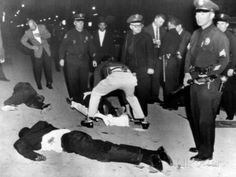 In 1962, police shot Black Muslims at Mosque 27 in South Central Los Angeles. Black Muslim leader Malcolm X denounced the violence. Photo credit: Howard Ballew / Herald Examiner