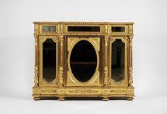 DesignaçãoPar de armários baixosMaterialmadeira entalhada e douradaDescriçãopainéis com espelhos, portas com vidros, tampos de mármoreOrigemportuguesesÉpoca