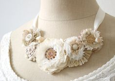 Wedding Floral Necklace in Ivory White, Cream and Blush. $146.00, via Etsy.