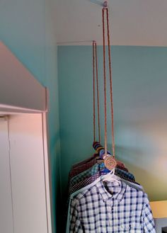DIY closet racks. Hang your clothes from the ceilings with rope, chain, and  some simple rods. Smart idea. |