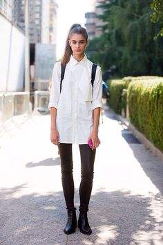 black high waisted trousers plus white oversized shirt, chelsea boots and black backpack