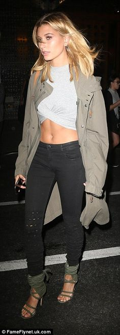 On the prowl:The stunner sported a grey crop top which showed off her ripped abs along with a pair of black skinny jeans