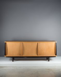 Jean Prouvé; Wood, Plywood and Enameled Metal Sideboard, 1945.