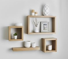 Solid American white oak floating cube shelves are made from the finest grade kiln dried white oak For a superior finish and distinctive appearance