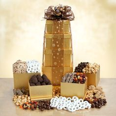 For the ultimate Snack Attack, this tower of 4 golden boxes filled with sweet and tasty treats is sure to be a hit! They'll love the white chocolate covered pretzels, crunchy chocolate chip cookies, creamy chocolate gourmet truffles, Almond Roca, ... - $49.99