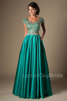Modest Prom Dress 2017 | LatterDayBride & Prom | SLC | Utah | Worldwide Shipping | Emily | Fall in love with this amazing modest prom dress. The two-tone bodice shows off an intricate gold lace pattern with a slim waistband and complimented by a rich pleated A-line skirt.     Dress available in Fuchsia, Emerald and Black    *Dress shown in Emerald