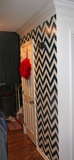 How To Paint Chevron Stripes On A Wall- would be cute to have one wall in pattern and the rest a solid color! :)