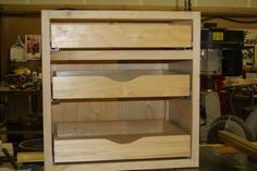 Base cabinet , One top drawer and two drawers behind doors