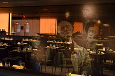 Ghosts in the mirrors. Images from past productions appear in the mirrors on Level 5 near the cafe. Photo by Chris Axelson.