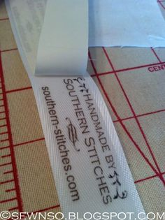 SewNso's Sewing Journal: DIY Labels!- She used iron on transfer with twill tape or ribbon.