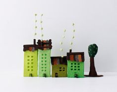 Four felt buildings with tree. Green colors Urban Miniature.