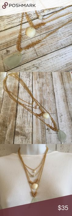 """Four layer chain necklace Four layer gold fashion chain necklace. Shells and seaglass are real and handpicked from the Island of Maui. Seaglass is 1-3/8"""" larger shell is 6/8"""". Small puka shell is 1/4"""". Mini white Rhinestone ball. Length is chain is 17-1/2"""". Extension 2"""". Lizzy & Jane Co Jewelry Necklaces"""