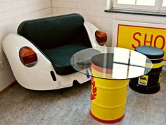 Volkswagen seat with an oil drum table - would love this for my sons' room, shared by www.highroadorganizers.com