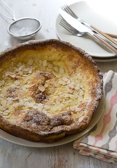 Almond Dutch Babies are a cross between a thick German pancake and a crepe.