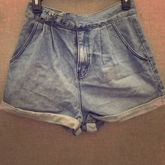 High wasted shorts Worn once for lollapalooza!! Super comfortable and looks good with crop tops! The buckle is a cute touch! Bought at urban outfitters! Perfect condition, no signs of wear at all! BDG Shorts Jean Shorts