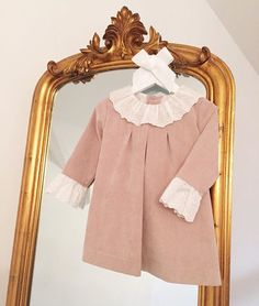 'Mia', beige dress with lovely white frilled collar and matching sleeves, ties in a bow at the back.  Available to purchase from our baby boutique at bellaandlucella.com