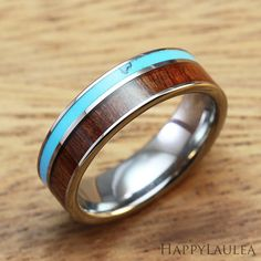 Tungsten Carbide Ring with Hawaiian Koa Wood and Turquoise Inlay (6mm width, flat style)    This tungsten ring features a Hawaiian koa wood inlay