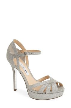 Pairing these glitter sandals with a LBD.