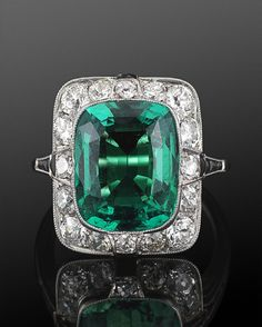 Art Deco 3.60ct Natural Colombian Emerald, Diamond and Onyx Ring, circa 1920 A cushion cut natural Colombian emerald weighing 3.60 carats, with AGL report stating there are no clarity enhancements, is mounted in a platinum old European cut diamond surround with calibré onyx.