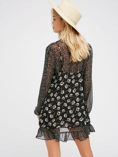 Dotty For You Mini | Gorgeous femme mixed print dress with an effortlessly layered look. Features a long sleeve dress layered underneath a simple slip. Cute tie accent at the V-neckline, adjustable straps on the slip and elastic at the sleeve cuffs for an easy fit. Pretty flowy shape.