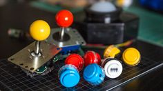 Knowing the differences between the many different kinds of arcade buttons and joysticks enables building a cabinet for exactly the kinds of games you want to play--or, by mixing and matching hardware, you can create a machine with inputs that are great for a wide swath of arcade genres. Here's what we learned while researching our arcade controls.