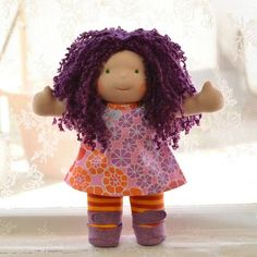 This is Tamsin, a classic Bamboletta doll. She has fair skin, long hair made with mohair boucle in a deep lilac color and green eyes.  She is wearing the pictured outfit, underpants and wool felt shoes.